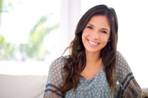 woman with a beautiful smile thanks to the dentist naples residents trust