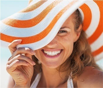 Laughing woman wearing sun hat