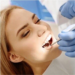 Woman receicing dental treatment