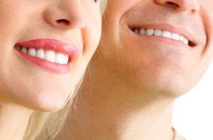 close up of woman and man smiling