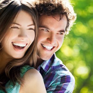 Couple with beautiful smiles thanks to the cosmetic dentist Naples prefers