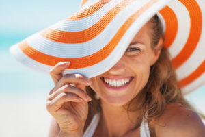 woman with summer hat smiling
