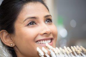 a woman getting porcelain veneers