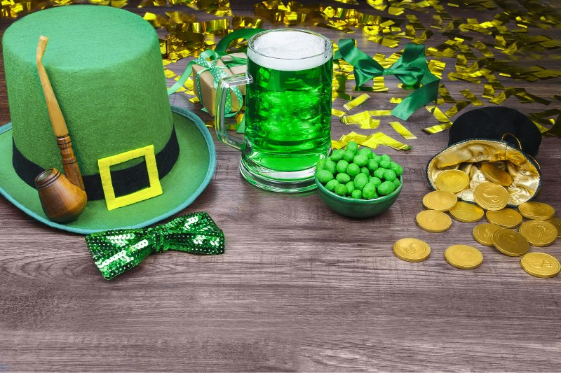 a green top hat, bow tie, pipe, beer, nuts, and a small pot of gold for St. Patrick's Day
